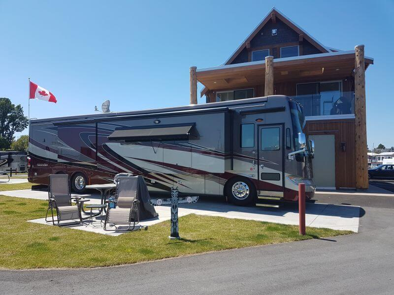 RV in front of building and Candian Flag