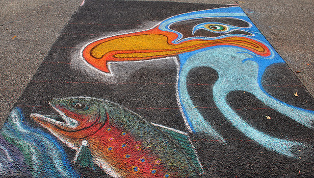 A First Nations-style seagull and salmon chalk drawing from the Victoria Chalk Art Festival, 2014. Photo credit @ngawangchodron on Flickr.