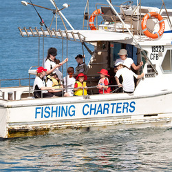 School kids on a fishing charter in New South Wales. Photo credit Henk Tobbe @vk2gwk on Flickr.